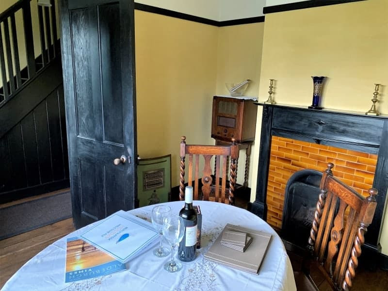 The dining room in the Vintage House with an original fireplace and radio.