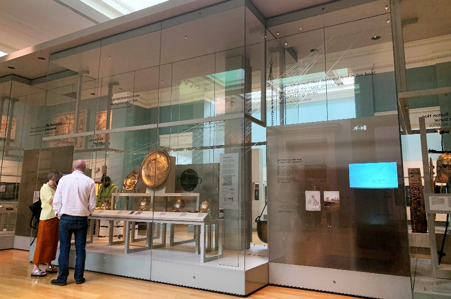 People looking into a display case