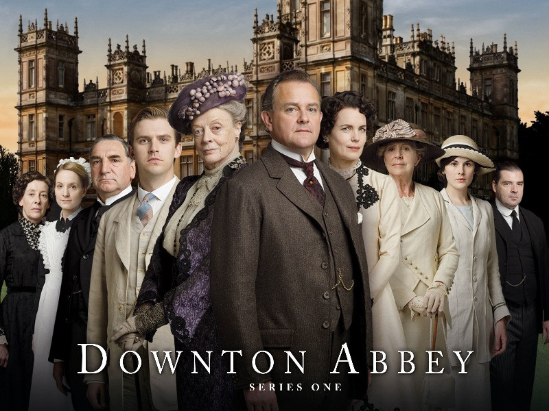 A cast photo of Downton Abbey outside Highclere Castle