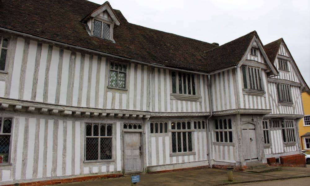 The exterior of the Guildhall showing the white timber framed building.