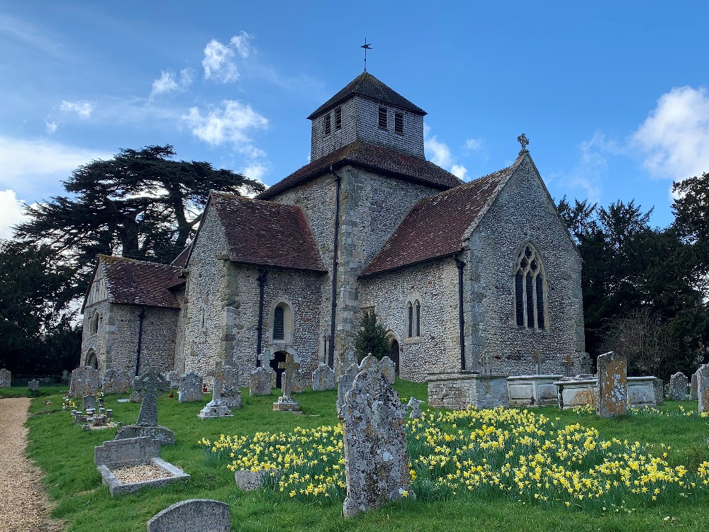 The exterior of St Mary Breamore with daffodils in the foreground