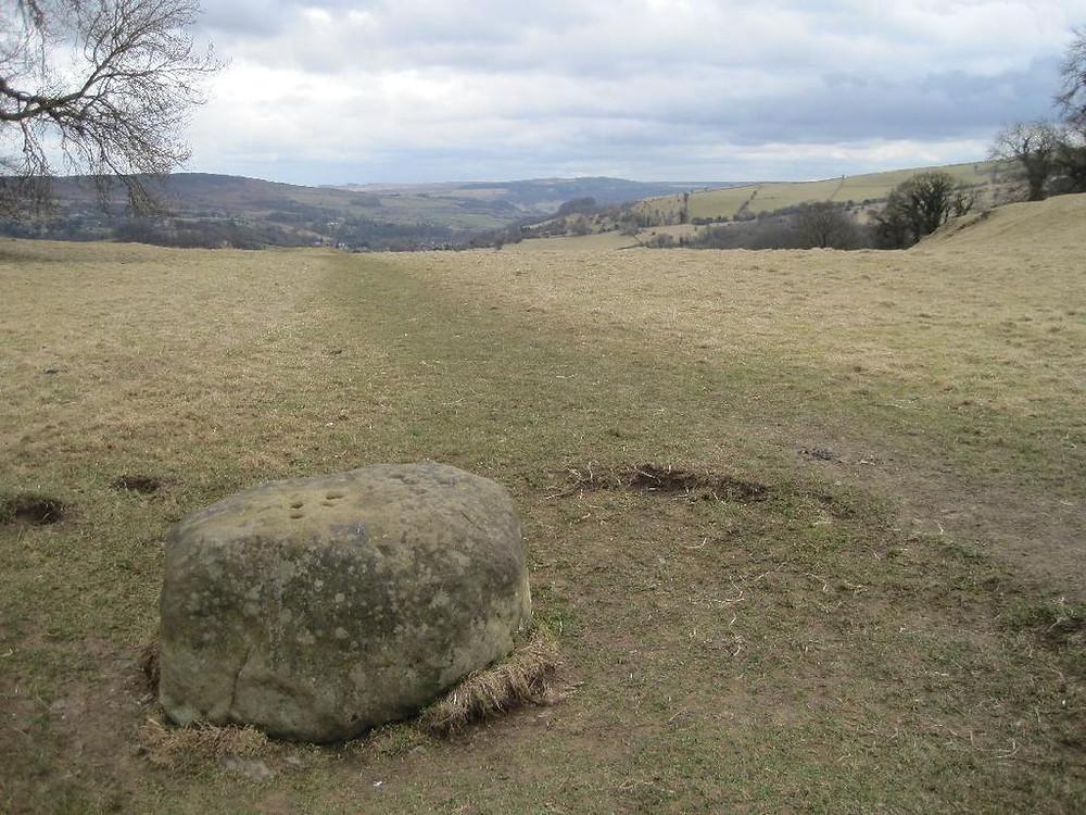 A large boundary stone on a hillside near Eyam