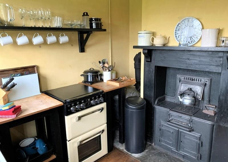 The kitchen in the Vintage House showing the original range.