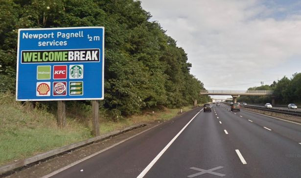 A road sign next to a motorway