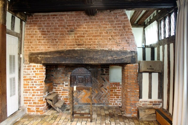 A close up of the medieval fireplace in the Lavenham Guildhall.