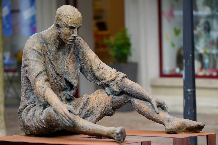 A sculpture of a man looking tired