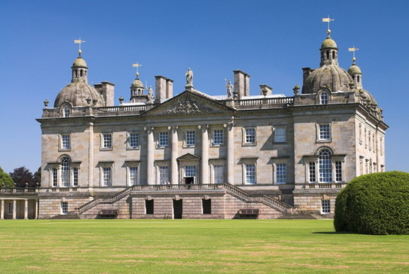 The outside and formal lawns of Houghton Hall in Norfolk.