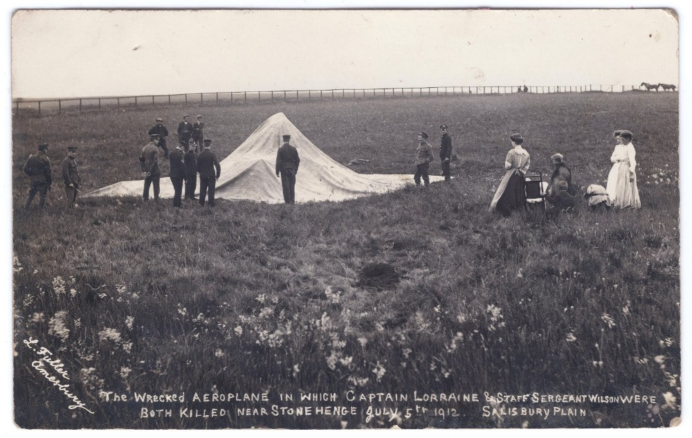 A black and white photo of the crash site with a sheet over it