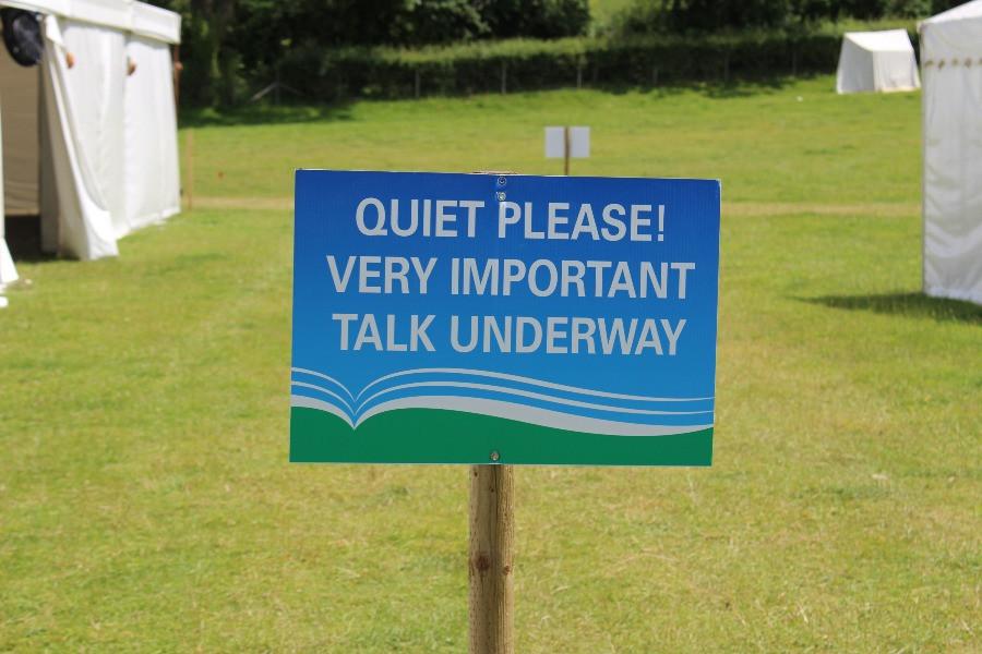 A sign saying 'quiet please vert important talk underway'