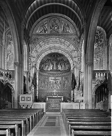 A black and white photo of the church before 1941, showing a orate interior.