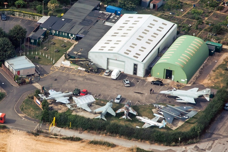 An aerial view of the Tangmere Aviation Museum hangars and planes