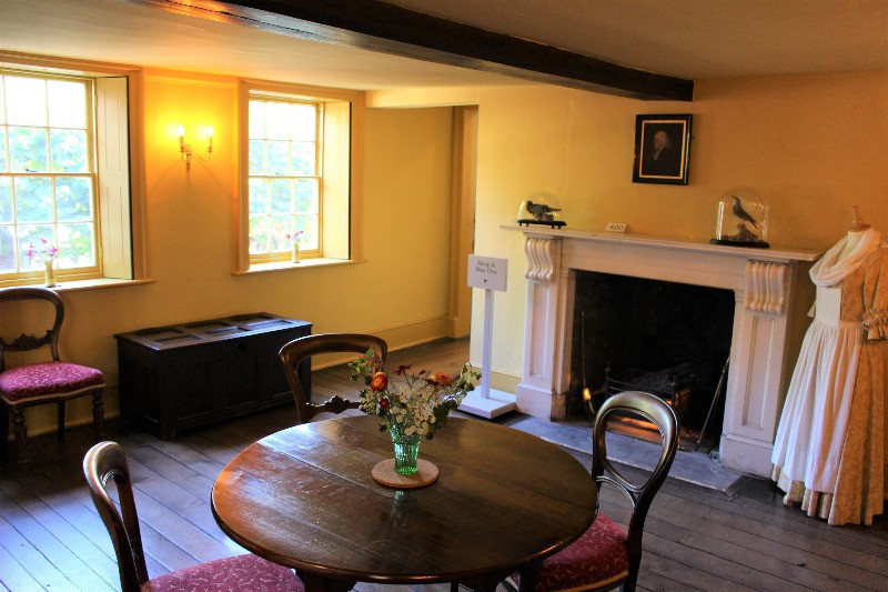 The parlour at the Wakes with a table and chairs