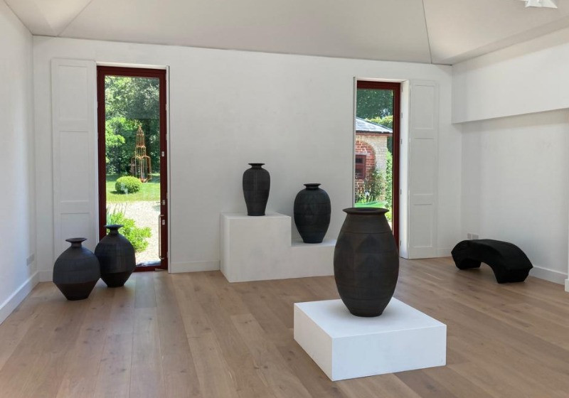 Urns on display in a gallery at Rocher Court