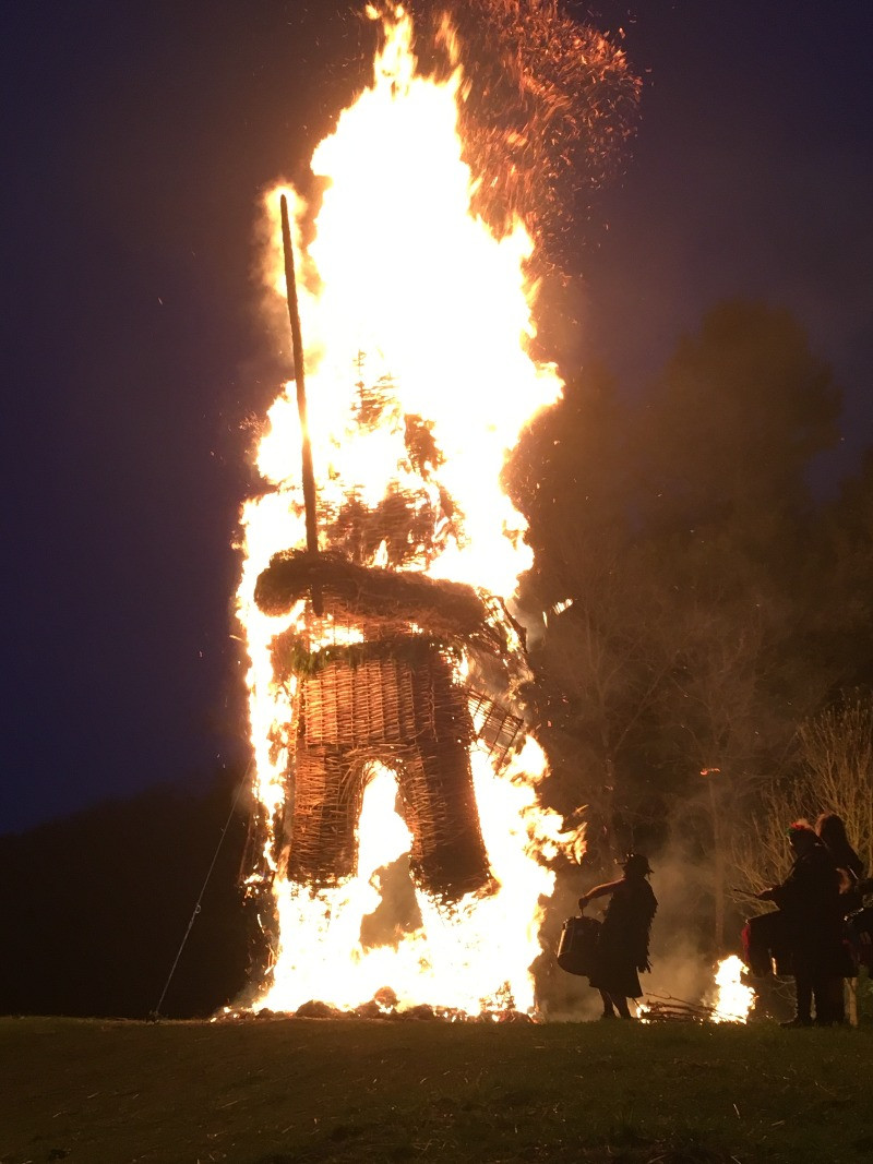 Druumers at the base of a burning wickerman