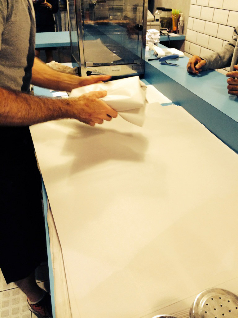 Matthew wraps food in paper in order to keep food crispy