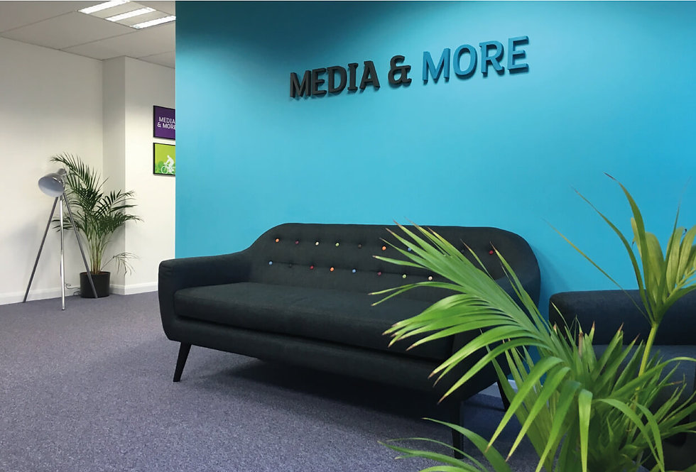 Media & more signage on reception wall