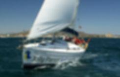 Branded yacht sailing around Gibralta