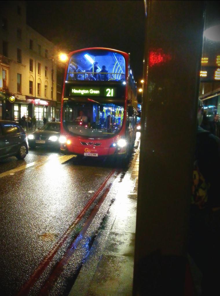 Double decker bus in rain