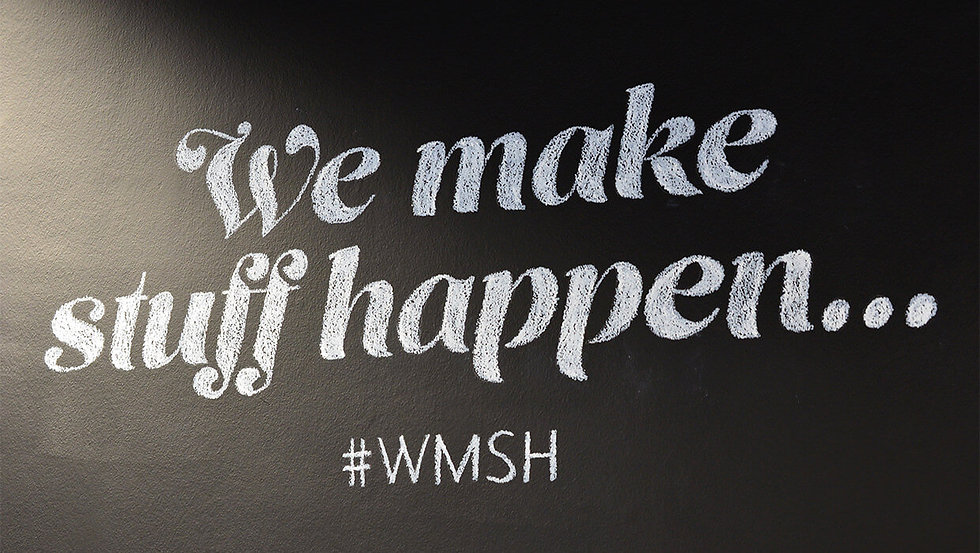 'We make stuff happen' chalked on a blackboard