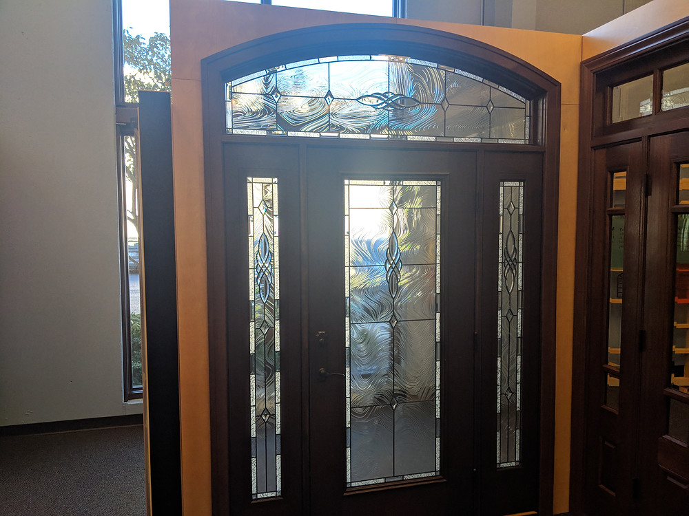 Door with specialty windows, sidelights, and a transom