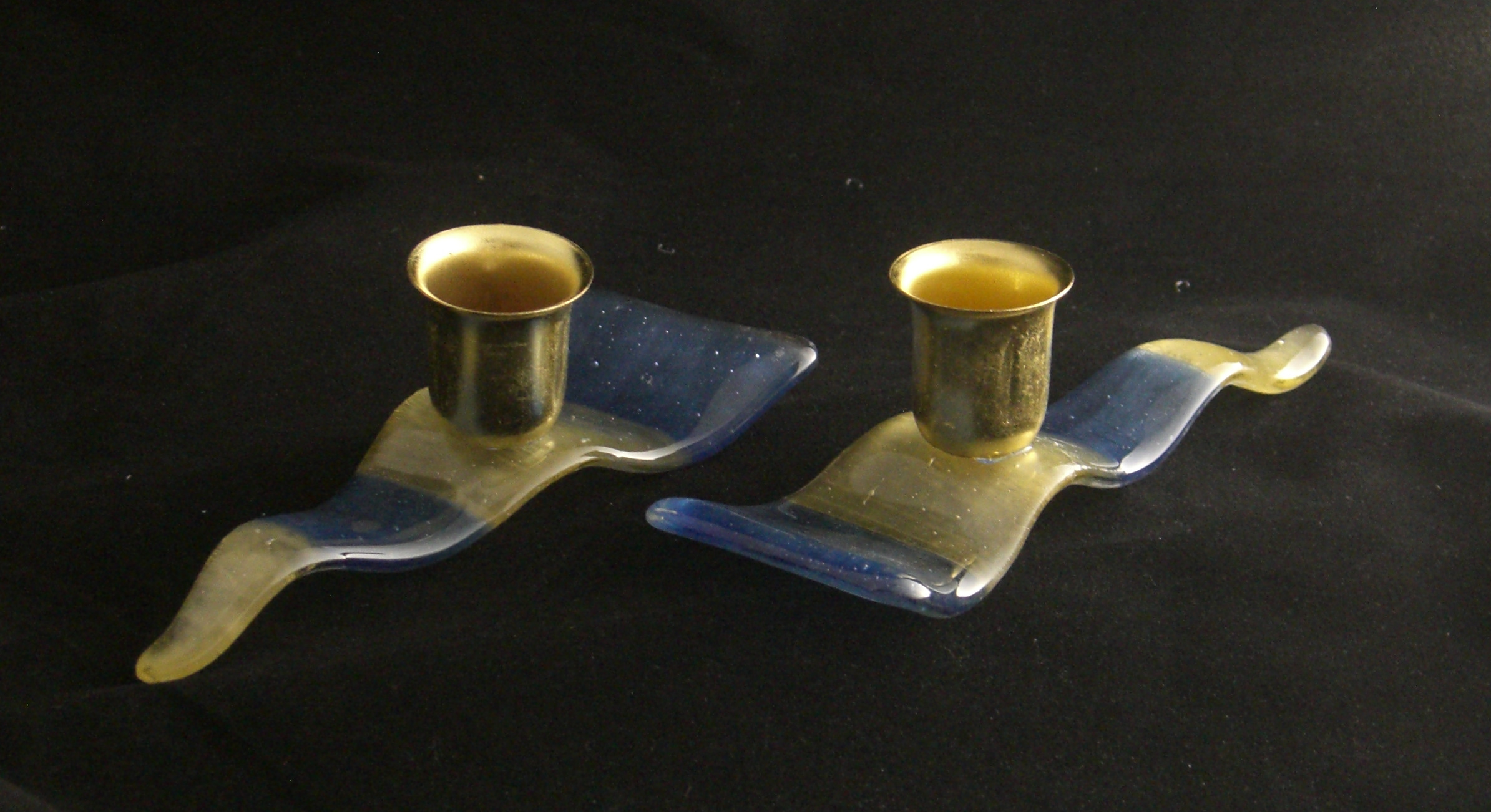 Shabbat waves of blue and gold candlesticks