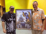 """Ed with Michael (Cruise Ship and Tasty Beverage aficionado) presenting his custom hand painted Giclee Canvas Reproduction of """"Sword of Solaris"""""""