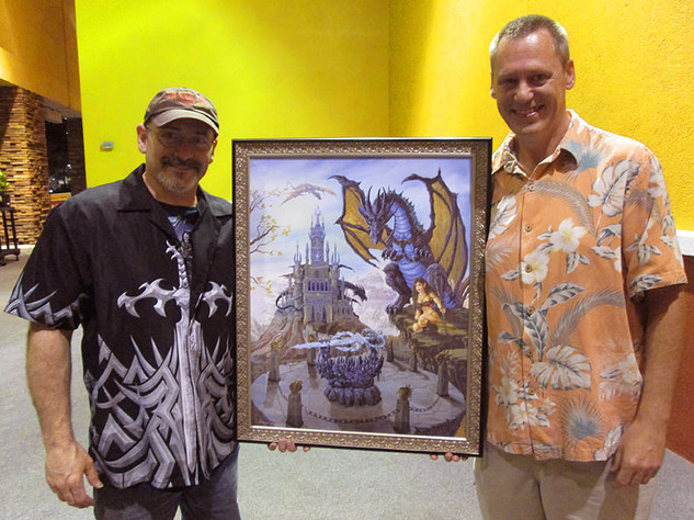 "Ed with Michael (Cruise Ship and Tasty Beverage aficionado) presenting his custom hand painted Giclee Canvas Reproduction of ""Sword of Solaris"""