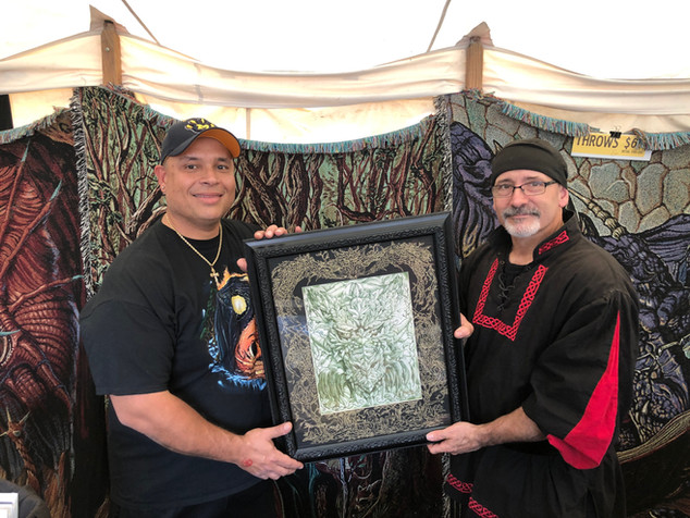 Longtime collectors with Ed holding a custom hand drawn mat illumination, custom framed.