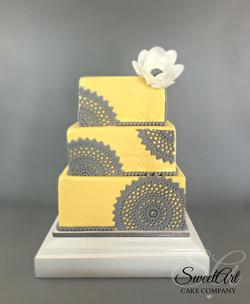 Yellow and Gray Doily Wedding Cake