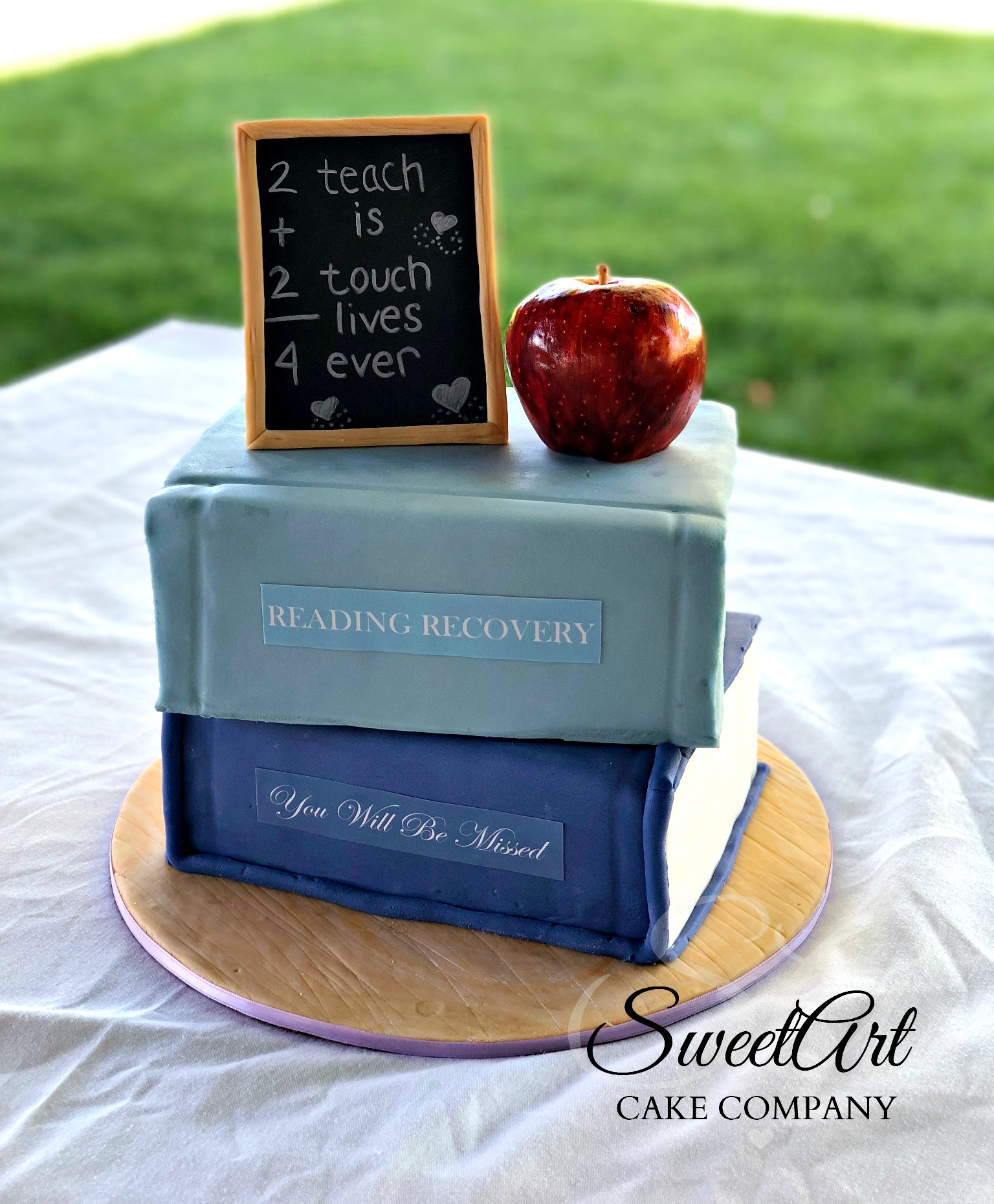 Book and Apple Teacher Retirement