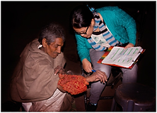 A female doctor is checking homeless man's hand