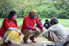Two Aashray adhikar abhiyan workers talking to homeless man