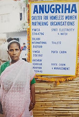 A female homeless resident standing in front of anugruha