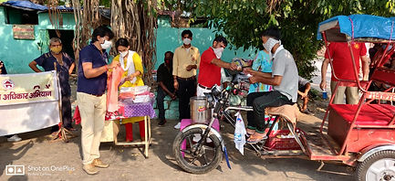 AAA social workers giving hygiene kit to a rickshaw puller