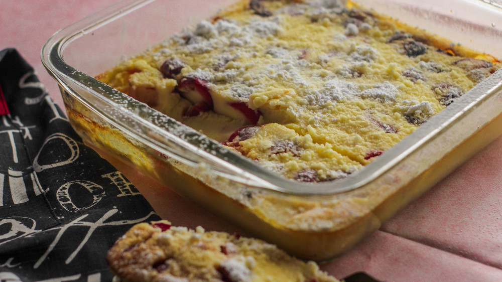 Yummy and fresh cherries which are baked in an egg custard base with vanilla extract and lightly dusted with powdered sugar.