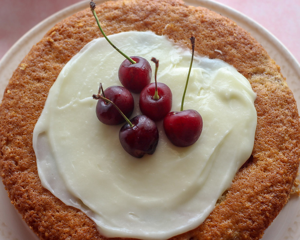 This fast and easy Cherry Cake is deliciously moist, made with almond and bursting with fresh cherries. You can serve it as it is or with a dollop of whipped cream. If you want to go nuts then serve with cream cheese frosting.