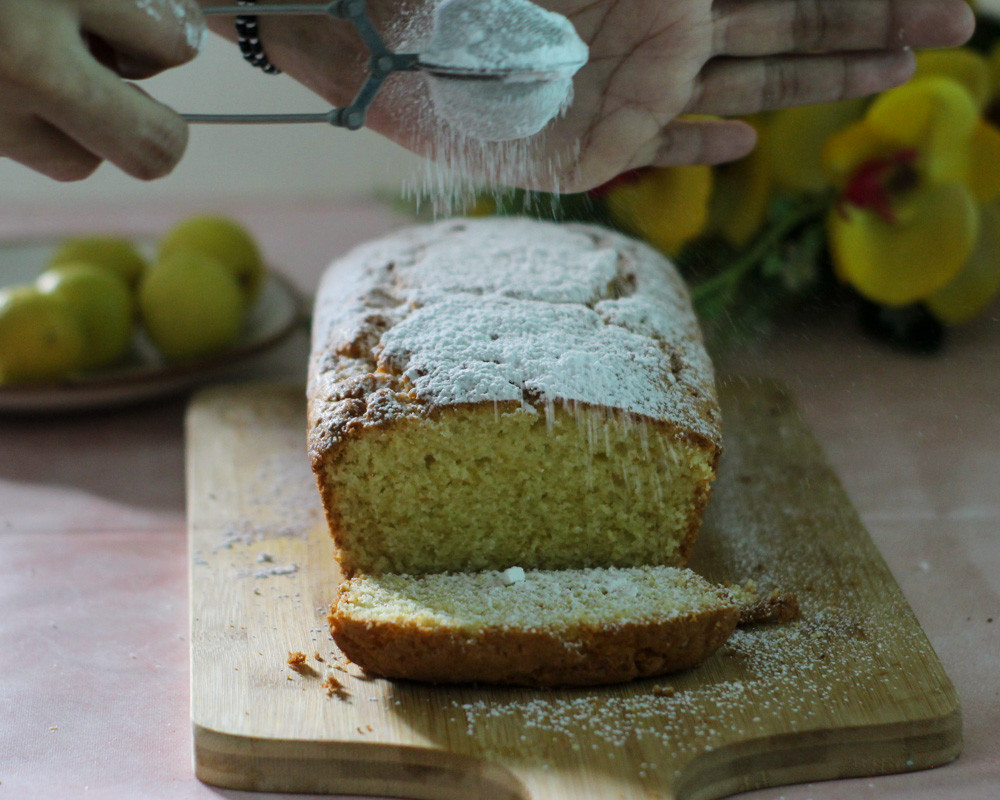 This is an ultra-soft, buttery and moist Lemon Ricotta Cake made with fresh lemon and ricotta cheese. For some extra sweetness, I dust my cake with some icing sugar. It's the season's perfect lemon dessert.