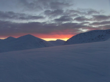 Sunset over the snow covered North West Highlands, Scotland.