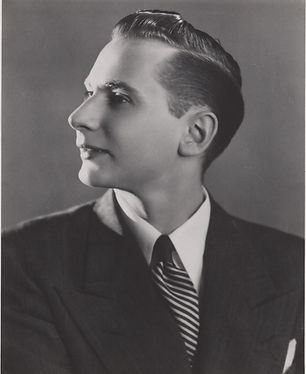 black and white photograph of a caucasian man in a suit and tie