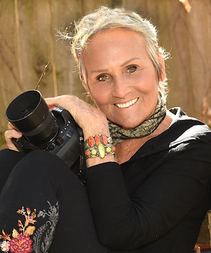 caucasian woman with a camera