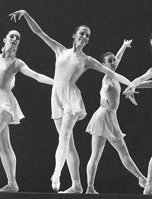 women ballerinas wearing pointe shoes in a black and white photograph