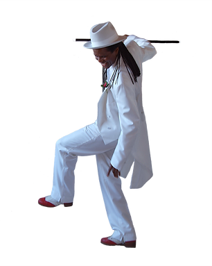 black man with long dreadlocks in a white tuxedo with tails and red tap shoes