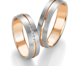 white-rose-gold-wedding-rings-by-breunin