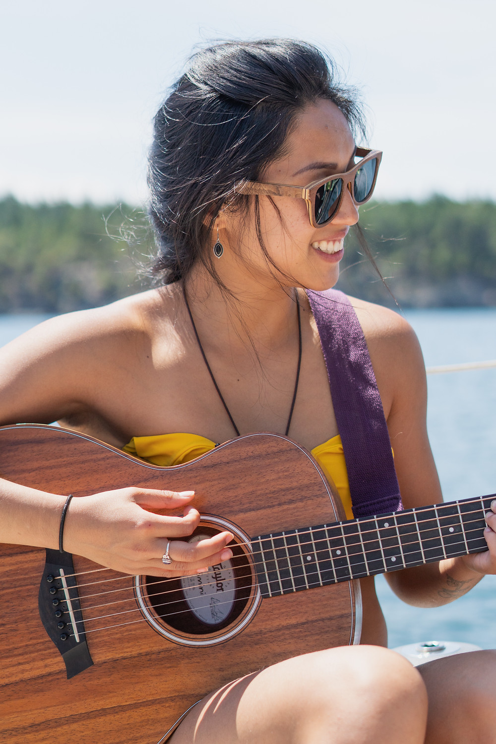 Photo shot by Gregory Wong, playing music on our sailing trip