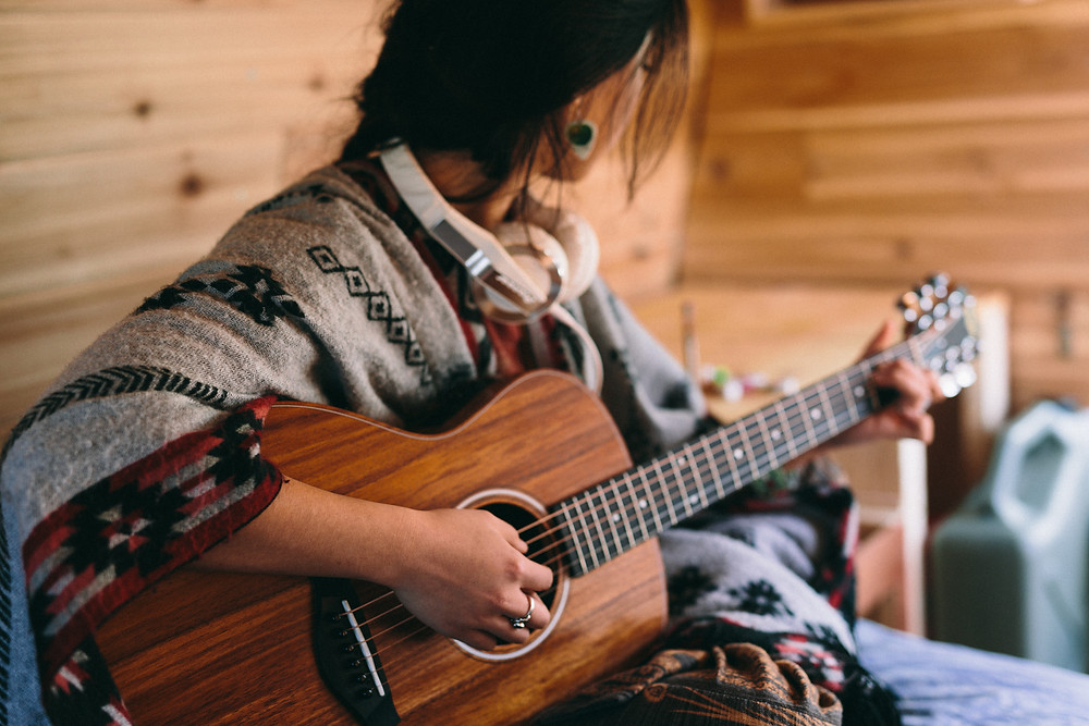 Van Lefan playing her kao wood Taylor GS Mini in her van