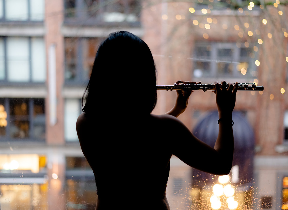Van Lefan Playing flute in Gastown, Vancouver. Photo taken by Arek Photography