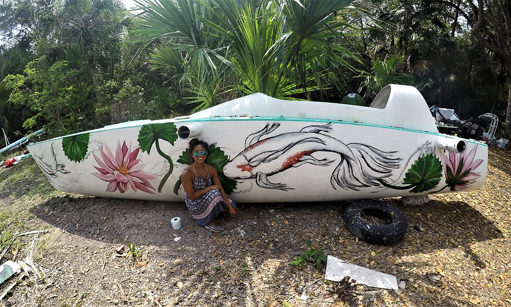 Me beside the koi pond side of the boat I painted