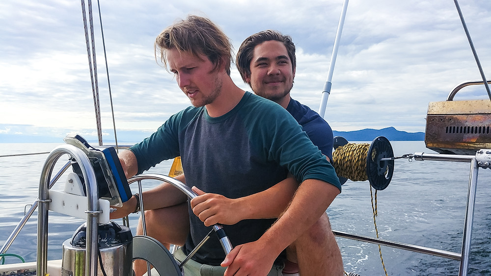 Greg and Forrest lovingly steering off into the sunset on a sailboat