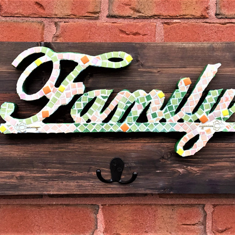 Family mosaic on wood board with hooks.j