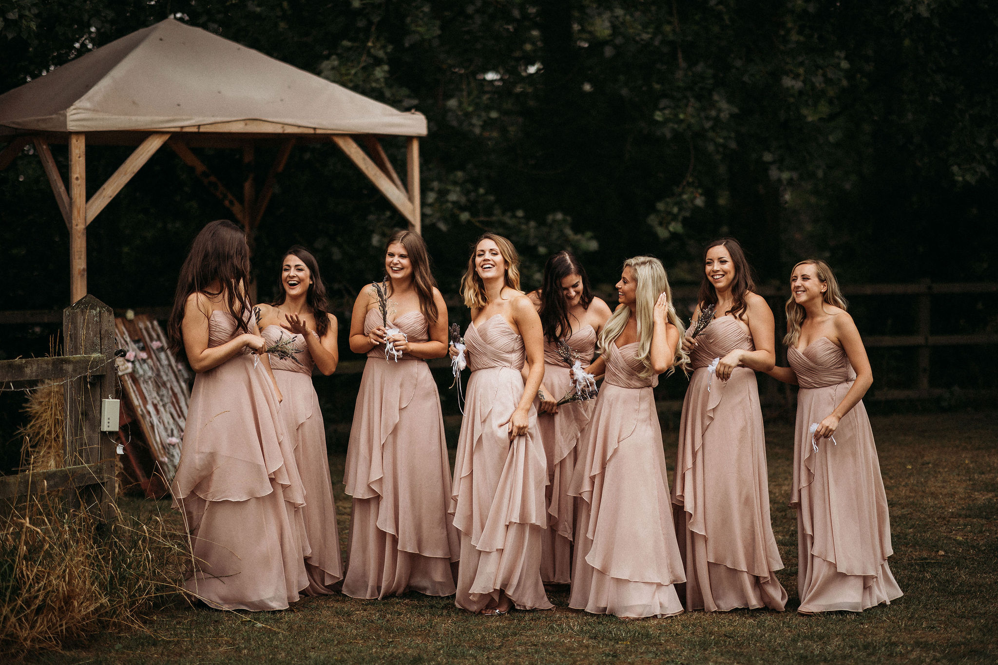 Bridesmaids in dusky pink dresses